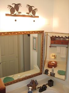 Red Pine Condo: Second vanity area showing mountain/western decor