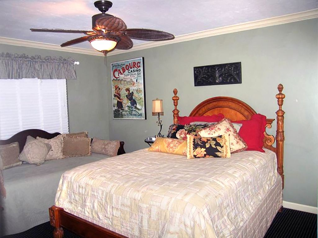 The guest room features a beautiful queen bed and twin daybed