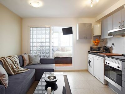 El Raval apartment rental - The living area and fully equipped American kitchen.