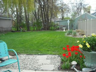 South Haven cottage photo - Private fenced backyard with fire pit & gas grill