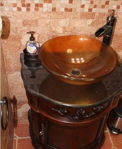 Modern Vessel Sink with retro Pump like facet. Beautiful.