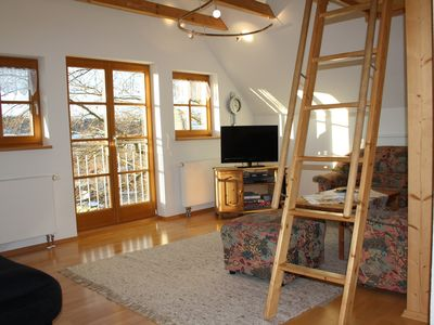 Attic apartment, living area with view