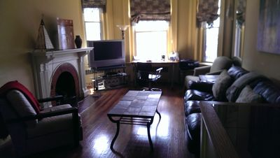 Living room sunset.  Beautiful hardwood floors.  Executive work area included.