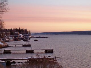 Munising villa photo - Sunrise from deck-Pictured Rocks Nat'l Lakeshore in the distance.