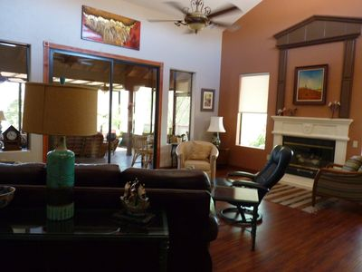 livingroom, with 46 inch tv, gas fireplace, doors go to screened in Arizona room