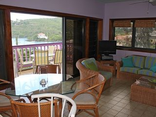 Cruz Bay condo photo - Living area includes dining area for 4 and sofa that includes a pull out bed.