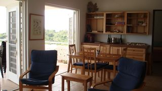 Vieques Island property rental photo - Guest House living area. The Dining table can be elongated to seat 8.