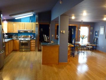 Full kitchen with wet bar and wine refrigerator and Bamboo floors throughout.