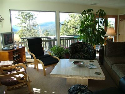 Floor to ceiling windows and comfortable seating in the main living area.