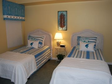 Newly updated Twin Bedroom with a beach theme, connects to 2nd bathroom.