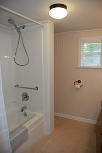 Pristine tub/shower - sparkling white