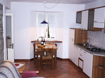 The bright kitchen of the apartment 3