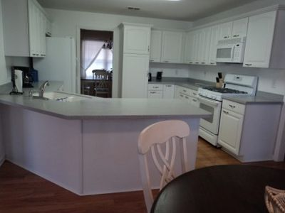 Fully equipped kitchen adjoins breakfast nook and separate dining room