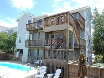 Mid Level Deck w/Hot Tub, Top Level Deck w/table for six and additional seating overlooks lake and both have gated access to pool area.