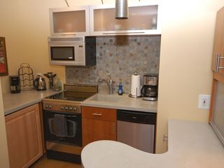 Downtown - Washington DC apartment photo - Gas stove/oven combo, under the counter refrigerator, microwave, coffeemaker