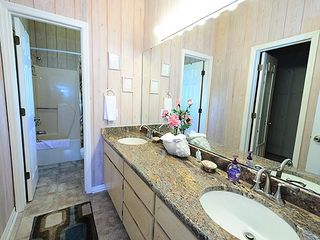 Master bath. Granite double vanity sinks and walk-in closet - Grayton Beach house vacation rental photo