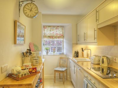 Sunny and immaculate kitchen supplied with everything you will need