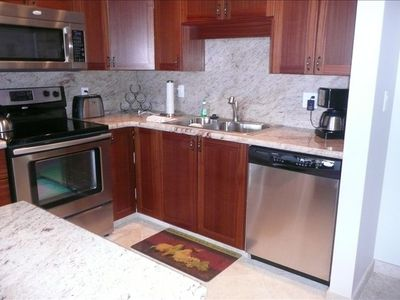 New granite countertops, cabinets, and appliances
