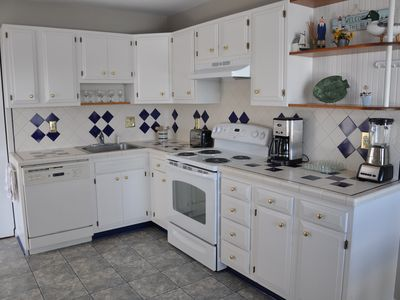 Renovated Kitchen with new fridge, stove and Washer/Dryer