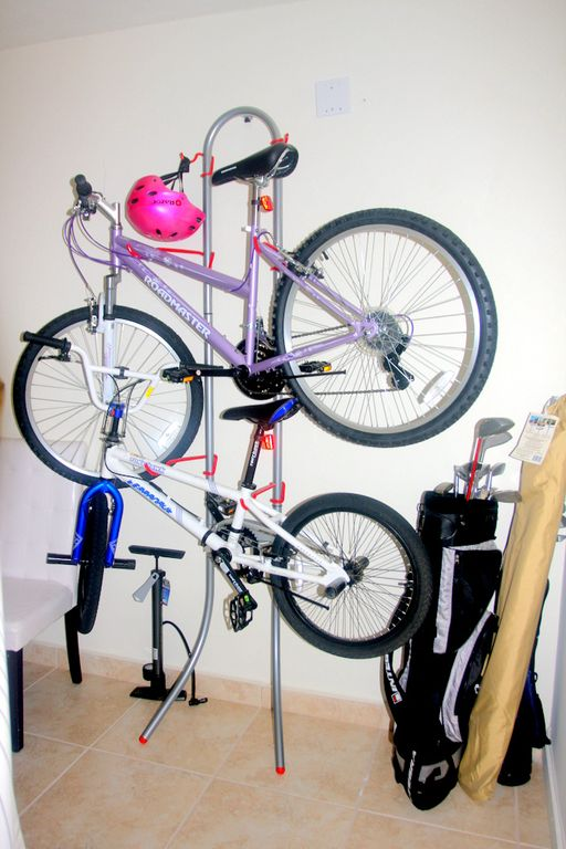 Bikes, beach umbrella, golf clubs, tennis rackets
