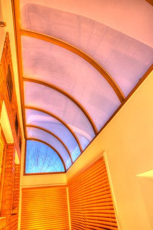 Huge Skylight over Living Rm & Kitchen brightens the Condo.