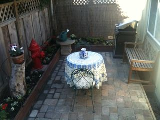 Pacific Grove cottage photo - fenced in back yard with cobblestone patio and gas grill.