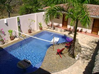 Tola house photo - Pool with sunken chessboard and volleyball net