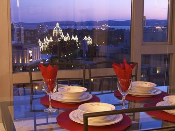 Victoria condo rental - Parliament buildings & cruise ship, lit up at night, from the dining room table