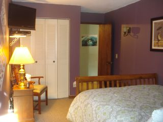 "Killington condo photo - Master bedroom with 27"" HD LED TV VHS/DVD w/remote."