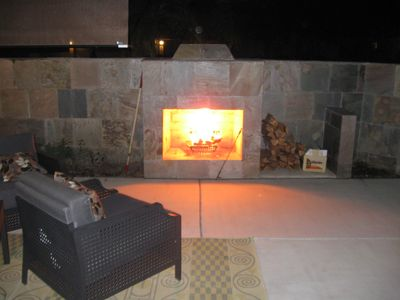 Front patio with beautiful gas fireplace at night and huge views during the day.