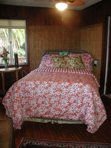 Full-sized antique bed in bedroom #1 with tropical cotton sheets and duvet.