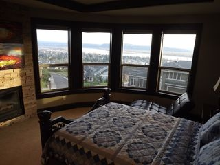 Vancouver house photo - Master bed has sweeping views, gas fire place