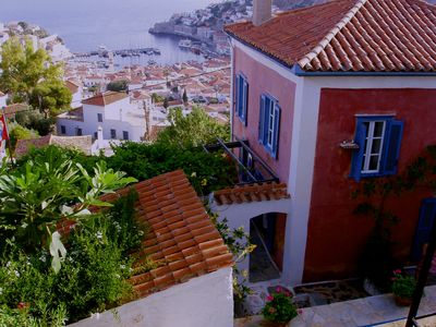 Hydra Island villa rental - View from one of the bedrooms to the port and the living room building