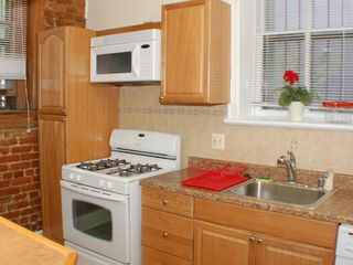 Capitol Hill apartment photo - Kitchen includes full sized refrigerator, gas stove/oven, microwave, dishwasher