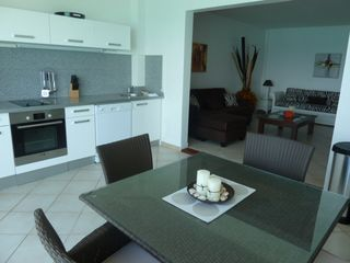 Grand Case apartment photo - Fitted kitchen and dining area