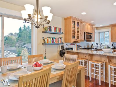 Open kitchen/dining area with breakfast bar is the perfect gathering place!