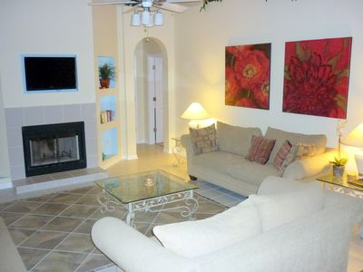 relax in the family room overlooking the pool and spa