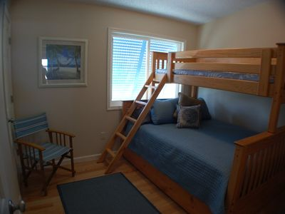 """Sand"" Family bedroom sleeps 4 in queen bed, twin bunk and trundle"