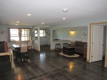 Lower level - walks out to grilling porch, path to beach