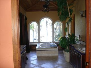 Tampa house photo - Master bathtub over looks lake
