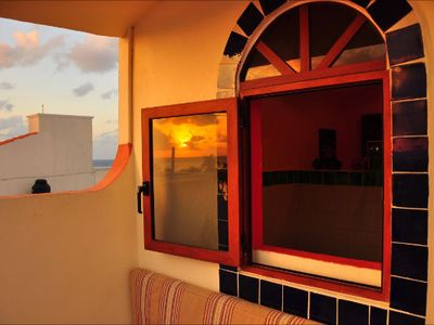 The bathroom shower window looks out to the sunset terrace of Casita Isladise.