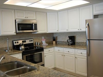 Kitchen with granite countertops and new stainless steel appliances