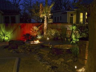 San Antonio bungalow photo - Decorative lighting of landscaping and koi pond for your private outdoor space