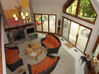 Big Canoe house photo - View from lounging loft overlooking den and deck areas.