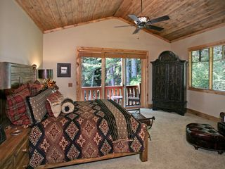 Sundance cabin photo - Master bedroom with deck overlooking stream. Double sided fireplace.