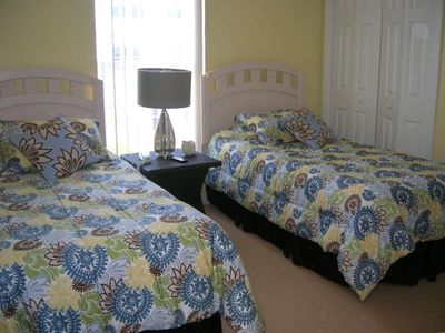 guest bedroom with comfortable twin beds and cable television