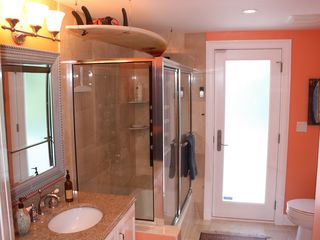 Old Naples house photo - Downstairs guest bath features full marble and multi-jet shower panel!