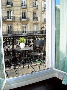 Enjoy Your Breakfast Croissant And Coffee on Your Paris Balcony!