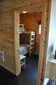 Bunk with double lower and twin upper beds