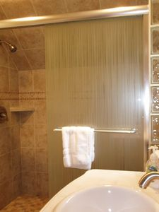 Tile shower with sliding doors upstairs.